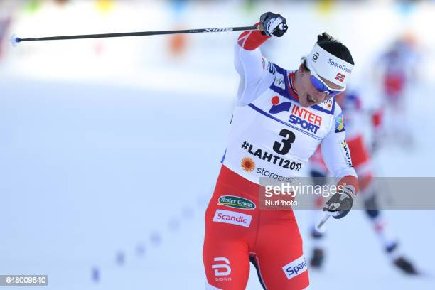 Marit Bjoergen celebrates after she wins her Fourth Gold Medal ahead of her Norway teammates Heidi Weng Astrid Uhrenholdt Jacobsen and Ragnhild...