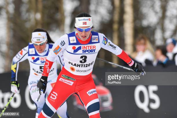 Marit Bjoergen from Norway and Charlotte Calla from Sweden during Ladies crosscountry 30 km Mass Start Free final at FIS Nordic World Ski...