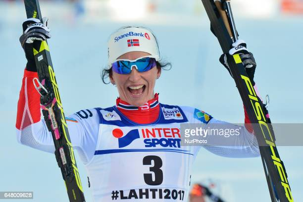 Marit Bjoergen from Norway celebrates after she wins Ladies crosscountry 30 km Mass Start Free and her FOURTH GOLD MEDAL at FIS Nordic World Ski...