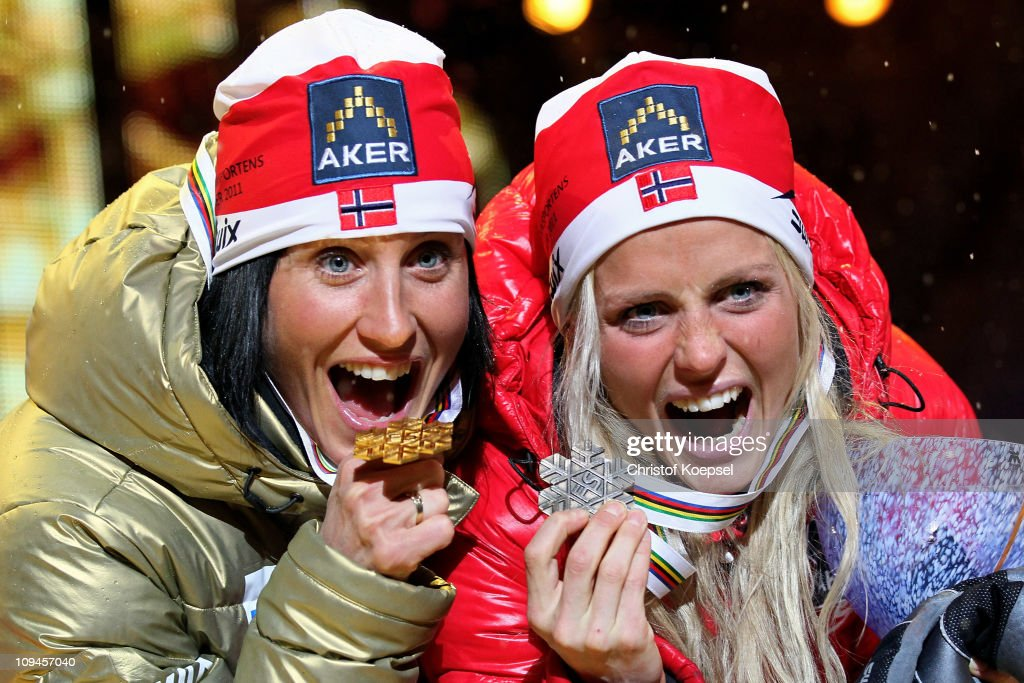 Marit Bjoergen (gold) of Norway and Therese Johaug (bronze) of Norway celebrate with the medals won in the Ladies Cross Country 15km Pursuit race during the FIS Nordic World Ski Championships at University Square on February 26, 2011 in Oslo, Norway.