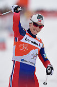 Marit Bjoergen of Norway celebrates after winning the Women's 10 km Pursuit Classic event for the FIS Cross Country World Cup Tour de Ski on January...