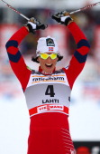 Marit Bjoergen of Norway celebrates the victory on the finish line during the women's individual sprint of the FIS World Cup Cross Country on March...