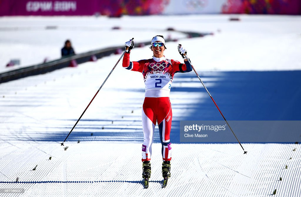 Marit Bjoergen of Norway celebrates winning gold in the Ladies' Skiathlon 7.5 km Classic + 7.5 km Free during day one of the Sochi 2014 Winter Olympics at Laura Cross-country Ski & Biathlon Center on February 8, 2014 in Sochi, Russia.