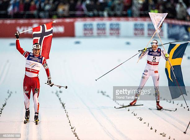 Marit Bjoergen of Norway celebrates winning the gold medal and Stina Nilsson of Sweden celebrates silver at the Ladies 14 km Sprint Classic Finals...