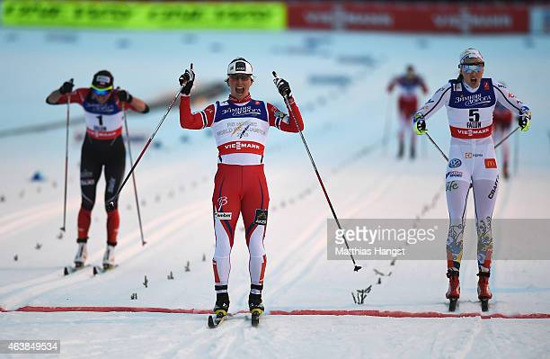 Marit Bjoergen of Norway celebrates winning the gold medal from silver medalist Stina Nilsson of Sweden in the Women's CrossCountry Sprint Final...