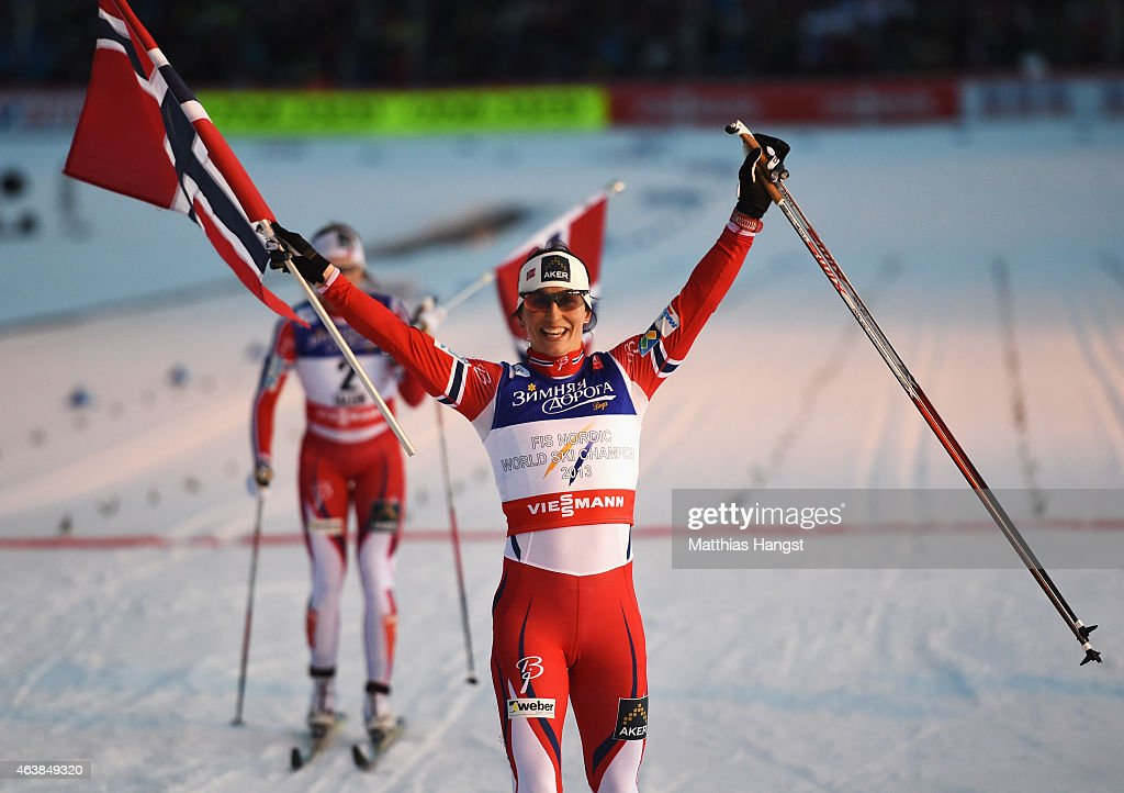 Marit Bjoergen of Norway celebrates winning the gold medal in the Women's Cross-Country Sprint Final during the FIS Nordic World Ski Championships at the Lugnet venue on February 19, 2015 in Falun, Sweden.