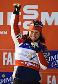 Marit Bjoergen of Norway celebrates winning the gold medal in the Women's CrossCountry Sprint Final during the FIS Nordic World Ski Championships at...