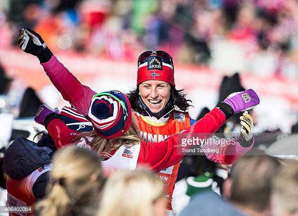 Marit Bjoergen of Norway celebrates winning with Therese Johaug of Norway after the FIS World Cup Lady 30 km Mass Start Free on March 15 2015 in...