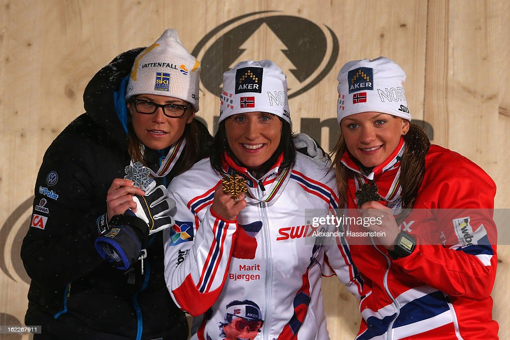 <a gi-track='captionPersonalityLinkClicked' href=/galleries/search?phrase=Marit+Bjoergen&family=editorial&specificpeople=216406 ng-click='$event.stopPropagation()'>Marit Bjoergen</a> of Norway celebrates with her Gold medal, alongside Silver medalist Ida Ingemarsdotter of Sweden (l) and Bronze medalist Maiken Caspersen Falla of Norway (r) at the medal ceremony for the Women's Cross Country 1.2km Classic Sprint Final at the FIS Nordic World Ski Championships on February 21, 2013 in Val di Fiemme, Italy.