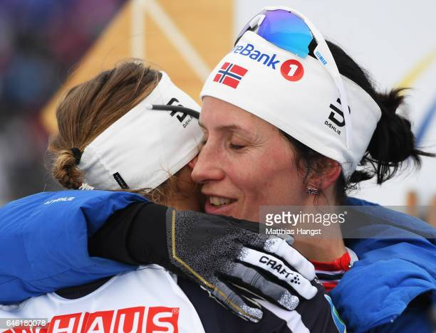 Marit Bjoergen of Norway celebrates with Ingvild Flugstad Oestberg of Norway after winning the Women's 10km Cross Country during the FIS Nordic World...