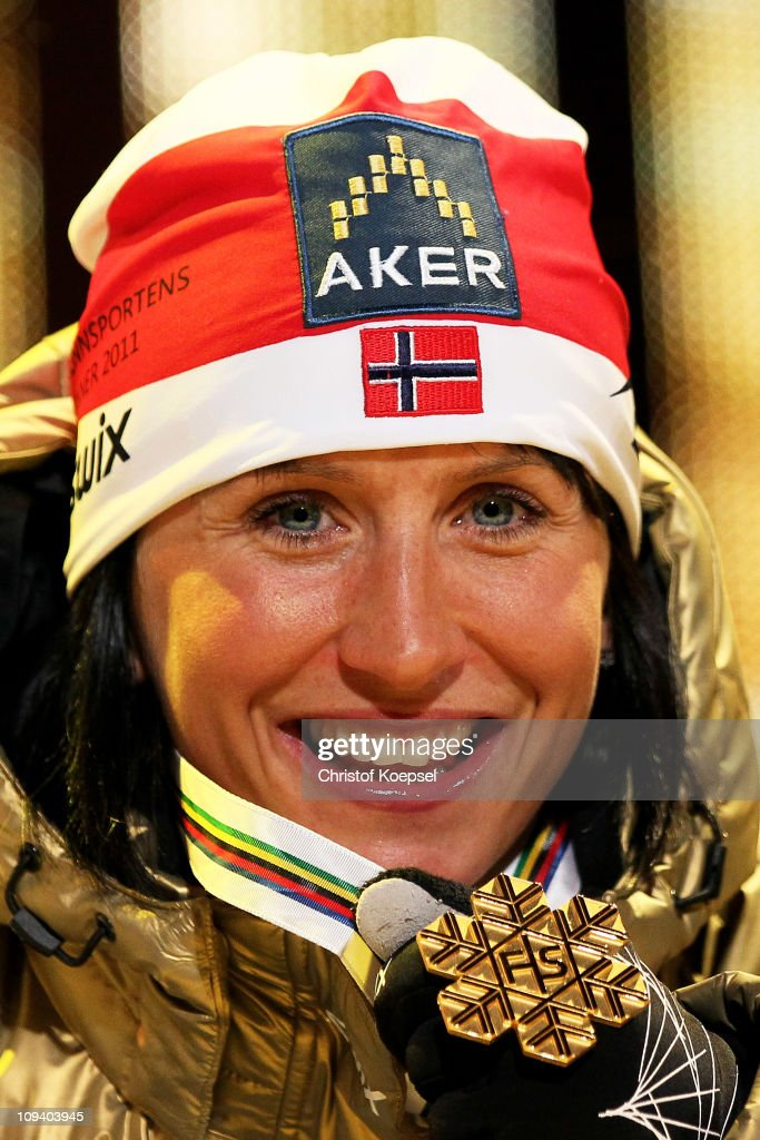 <a gi-track='captionPersonalityLinkClicked' href=/galleries/search?phrase=Marit+Bjoergen&family=editorial&specificpeople=216406 ng-click='$event.stopPropagation()'>Marit Bjoergen</a> of Norway celebrates with the gold medal won in the Ladies Cross Country Sprint race during the FIS Nordic World Ski Championship at Holmenkollen on February 24, 2011 in Oslo, Norway.