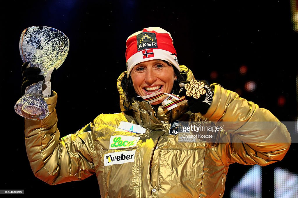 Marit Bjoergen of Norway celebrates with the gold medal won in the Ladies Cross Country Sprint race during the FIS Nordic World Ski Championship at Holmenkollen on February 24, 2011 in Oslo, Norway.