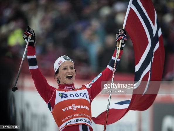 Marit Bjoergen of Norway celebrates with the Norwegian Flag after her win during the FIS CrossCountry World Cup Ladies 30 km Mass Start Classic on...