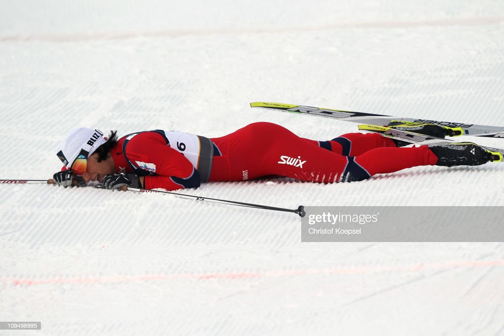 Marit Bjoergen of Norway collapses after crossing the finish line to win the gold medal in the Ladies Cross Country 10km Classic race during the FIS Nordic World Ski Championships at Holmenkollen on February 28, 2011 in Oslo, Norway.