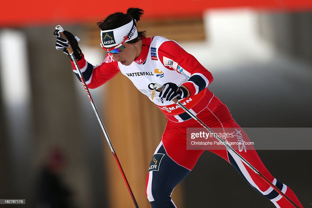 Marit Bjoergen of Norway competes during the FIS Nordic World Ski Championships Cross Country Women's Distance on February 26, 2013 in Val di Fiemme, Italy.
