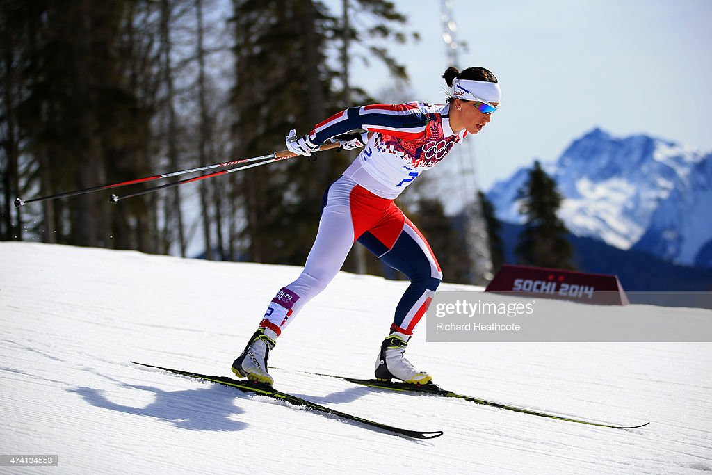 Marit Bjoergen of Norway competes during the Women's 30 km Mass Start Free during day 15 of the Sochi 2014 Winter Olympics at Laura Cross-country Ski & Biathlon Center on February 22, 2014 in Sochi, Russia.