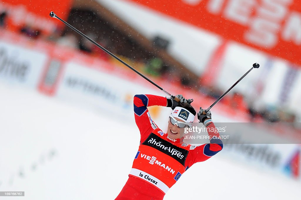 Marit Bjoergen of Norway crosses the finish line to win the Ladies' Nordic skiing combined World Cup relay (4 x 5 km) on January 20, 2013 in La Clusaz, eastern France.
