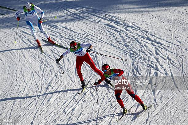 Marit Bjoergen of Norway gold leads Justyna Kowalczyk of Poland and Petra Majdic of Slovenia during the Women's Individual Sprint C Final on day 6 of...
