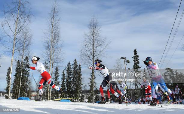 Marit Bjoergen of Norway Heidi Weng of Norway and Krista Parmakoski of Finland compete in the Women's Cross Country Skiathlon during the FIS Nordic...
