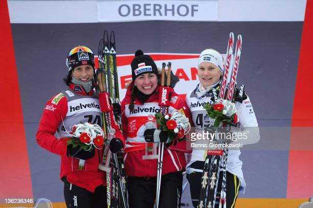 Marit Bjoergen of Norway Justyna Kowalczyk of Poland and Hanna Brodin of Sweden pose after the FIS Tour de Ski Oberhof Women's Prolouge at DKB Ski...