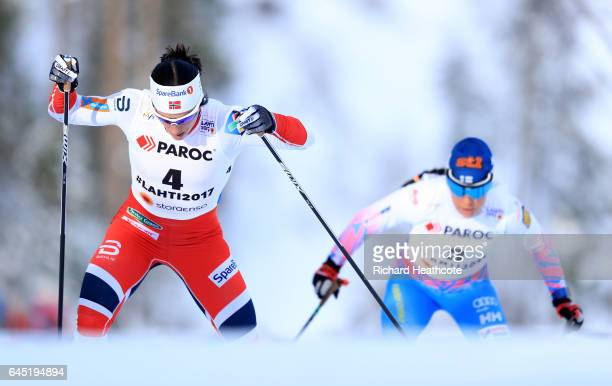 Marit Bjoergen of Norway leads as Krista Parmakoski of Finland chases during the Women's Cross Country Skiathlon during the FIS Nordic World Ski...