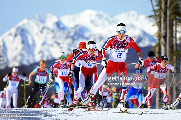 Marit Bjoergen of Norway leads the pack during the Women's 30 km Mass Start Free during day 15 of the Sochi 2014 Winter Olympics at Laura...