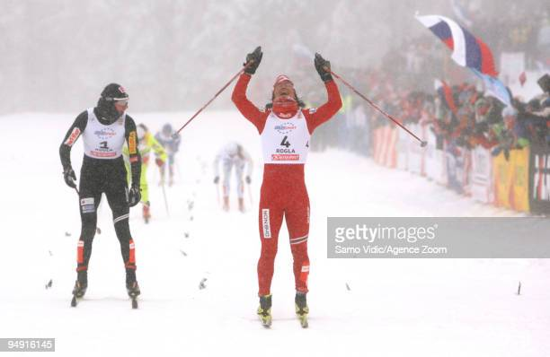Marit Bjoergen of Norway takes 1st place Justyna Kowalczyk of Poland takes 2nd place during the Viessman CrossCountry FIS World Cup Women's 10 km...