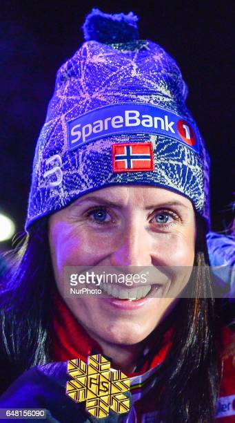 Marit Bjoergen with her fourth Gold medal at the Award Ceremony of Ladies crosscountry 30 km Mass Start Free final at FIS Nordic World Ski...