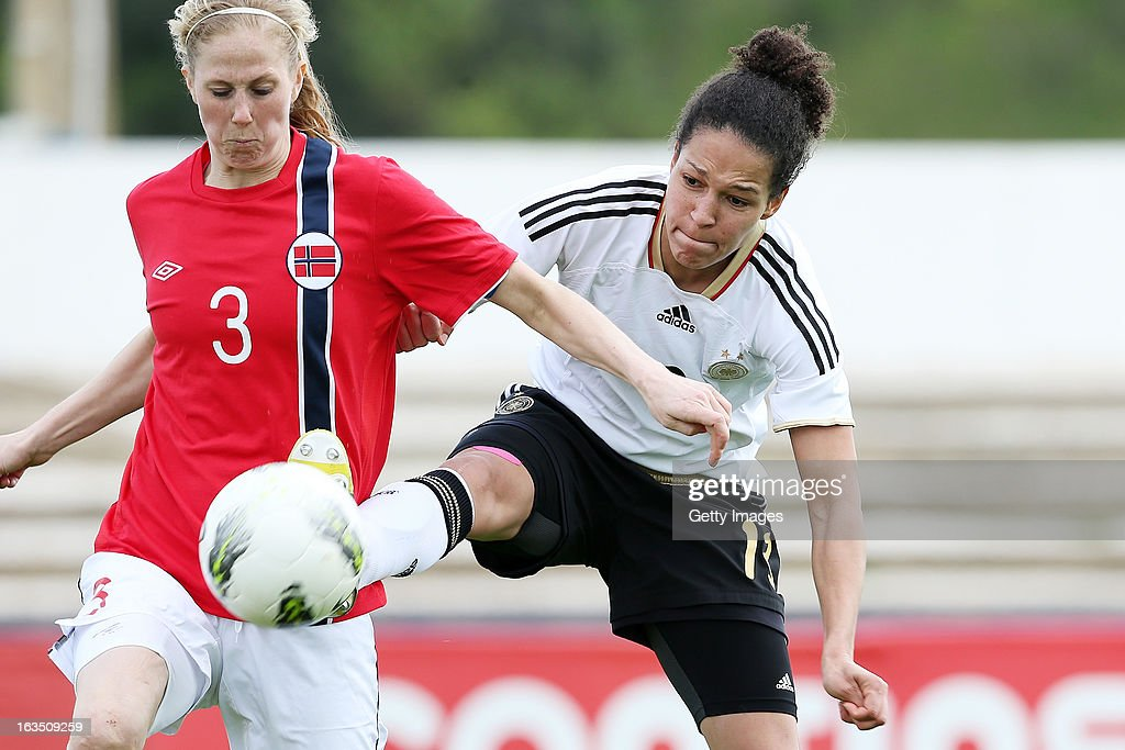 Marit F. Christensen #3 of Norway challenges Celia Okoyino Da Mbabi #13 of Germany during the Algarve Cup 2013 match between Norway and Germany at the Estadio Municipal de Lagos on March 11, 2013 in Lagos, Portugal.