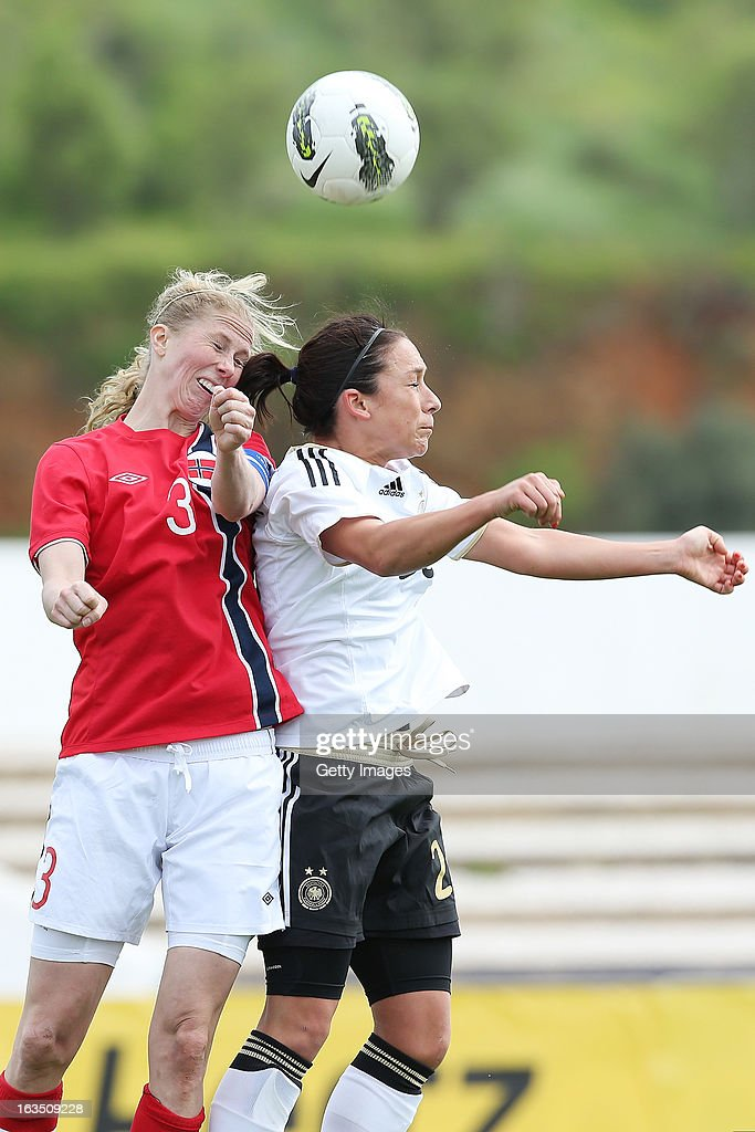 Marit F. Christensen #3 of Norway challenges Nadine Kebler #26 of Germany during the Algarve Cup 2013 match between Norway and Germany at the Estadio Municipal de Lagos on March 11, 2013 in Lagos, Portugal.