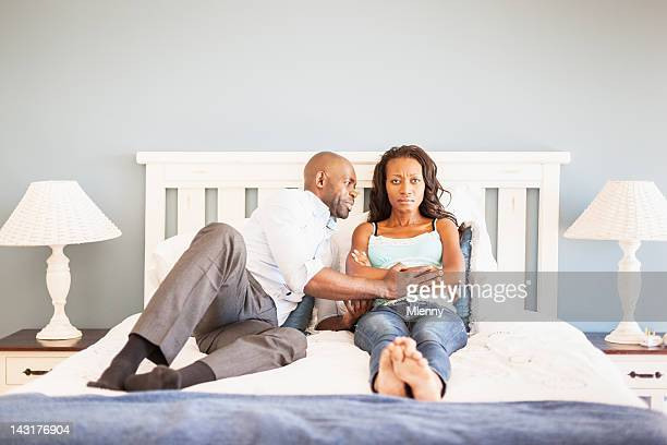 Marital Problems Sulking Wife and Pleading Husband in Bedroom