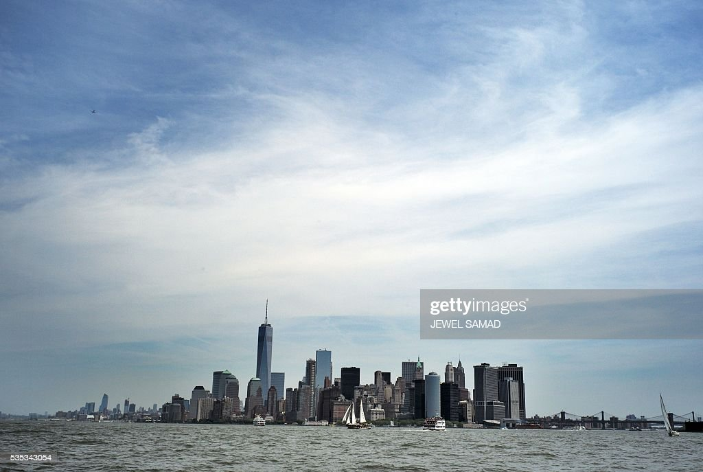 Maritime vessels sail on the Hudson River near the downtown Manhattan on May 29, 2016 in New York. / AFP / Jewel SAMAD