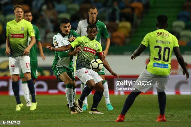 Maritimo midfielder Eber Bessa from Brazil with Sporting CP midfielder Rodrigo Battaglia from Argentina in action during the Portuguese League Cup...
