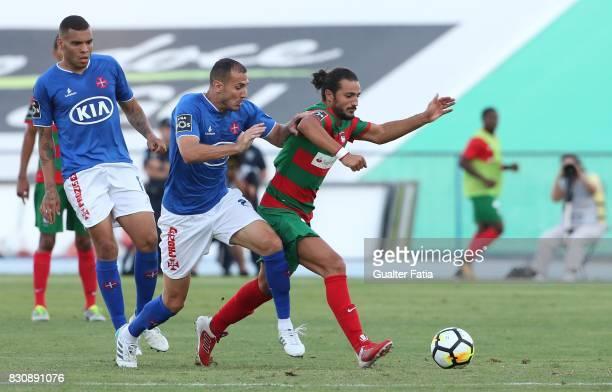 Maritimo midfielder Erdem Sen from Turkey with CF Os Belenenses midfielder Hassan Yebda from Algeria in action during the Primeira Liga match between...