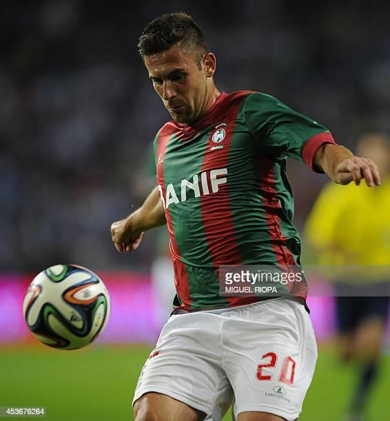 Maritimo's Brazilian midfielder Bruno Gallo controls the ball during the Portuguese league football match FC Porto vs Maritimo at the Dragao Stadium...