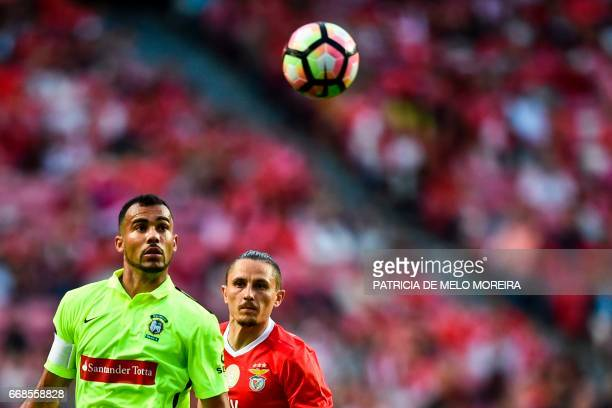 Maritimo's Brazilian midfielder Fransergio Barbosa vies with Benfica's Serbian midfielder Ljubomir Fejsa during the Portuguese league football match...