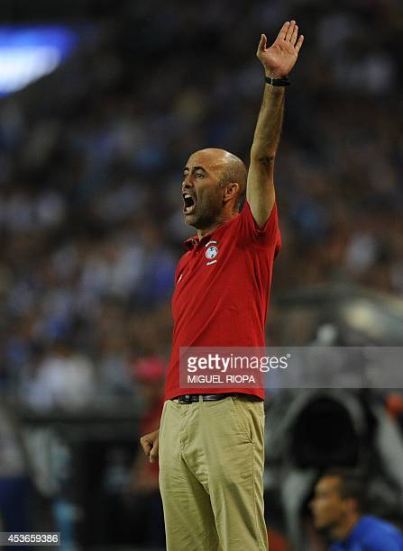 Maritimo's coach Leonel Pontes gestures during the Portuguese league football match FC Porto vs Maritimo at the Dragao Stadium in Porto on August 15...