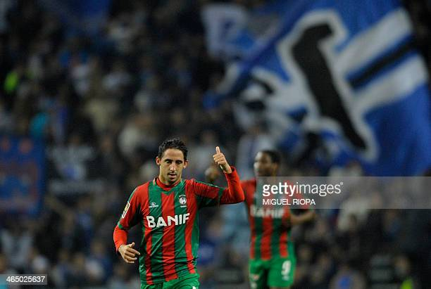 Maritimo's defender Joao Diogo gives the thumbs up after scoring during the Portuguese League Cup football match FC Porto vs Maritimo at the Dragao...
