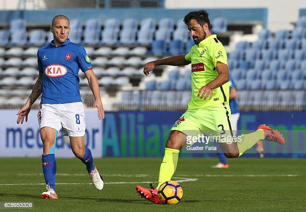 Maritimo's defender Mauricio Carvalho from Brazil with Belenenses's midfielder Andre Sousa from Portugal in action during the Primeira Liga match...