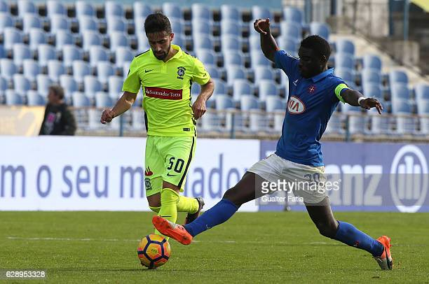 Maritimo's forward Antonio Xavier from Portugal with Belenenses's forward Abel Camara from Portugal in action during the Primeira Liga match between...