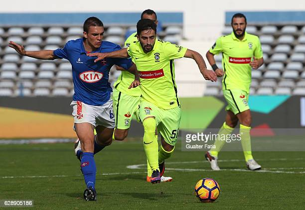 Maritimo's forward Antonio Xavier from Portugal with Belenenses's midfielder Joao Palhinha from Portugal in action during the Primeira Liga match...
