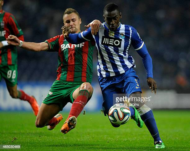 Maritimo's German defender Bauer vies with Porto's Colombian forward Jackson Martinez during the Portuguese League Cup football match FC Porto vs...