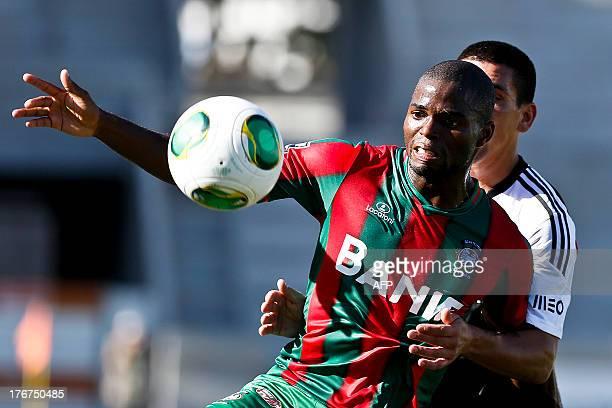 Maritimo's Guinean forward Leocisio Sami controls the ball during Portuguese League football match Maritimo vs SL Benfica at Barreiros Stadium in...