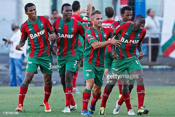 Maritimo's Guinean forward Leocisio Sami reacts after scoring during the Portuguese League football match Maritimo vs SL Benfica at Barreiros Stadium...