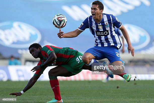 Maritimo's Liberian midfielder Theo Weeks vies with FC Porto's Brazilian midfielder Carlos Eduardo during the Portuguese League football match...