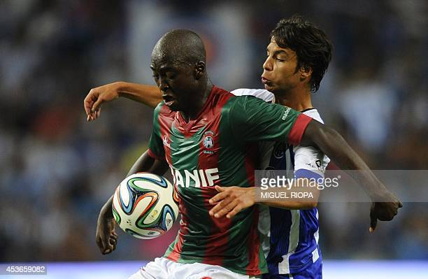 Maritimo's midfielder Danilo Pereira vies with Porto's Spanish midfielder Oliver Torres during the Portuguese league football match FC Porto vs...
