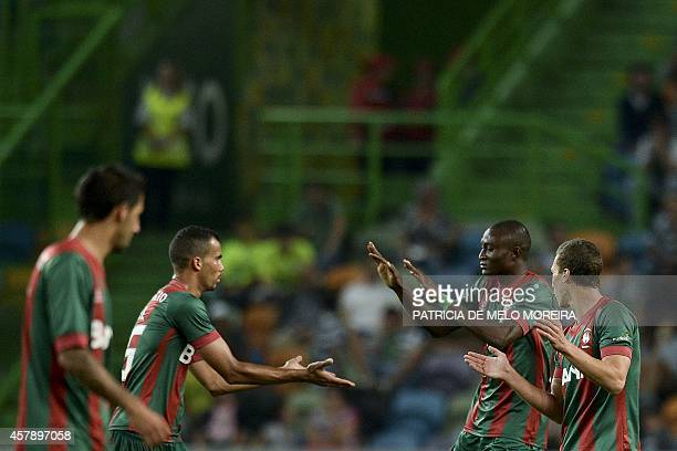 Maritimo's Nigerian forward Ouwo Maazou celebrates after scoring against Sporting during the Portuguese league football match Sporting CP vs Maritimo...