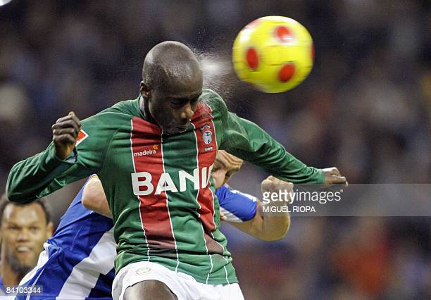 CS Maritimo's Papa Diawara 'Baba' from Senegal heads the ball next FC Porto's Argentinian Cristian Rodriguez during their Portuguese First league...