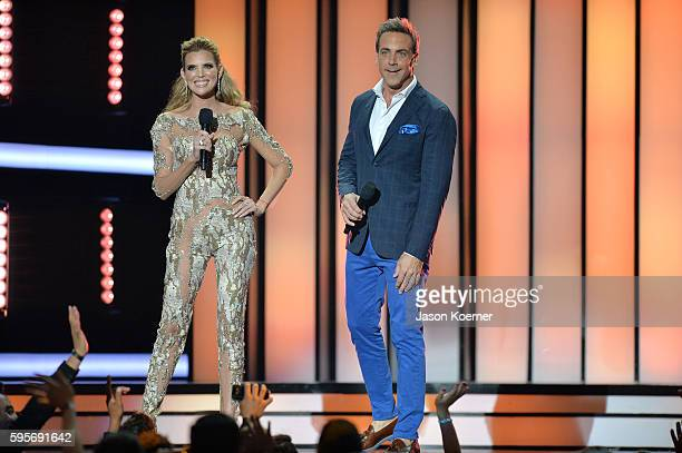 Maritza Rodriguez and Carlos Ponce onstage at Telemundo's Premios Tu Mundo 'Your World' Awards>> at American Airlines Arena on August 25 2016 in...