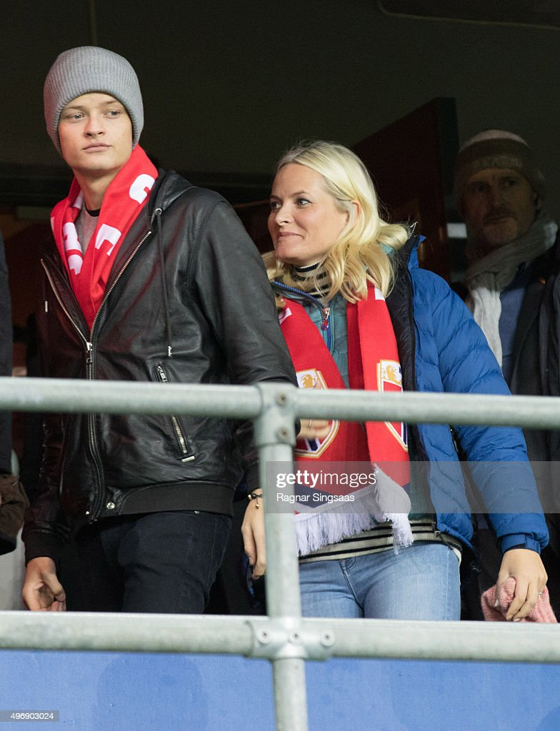 Marius Borg Hoiby and Crown Princess Mette-Marit of Norway attend the Play Off Game Between Norway and Hungary on November 12, 2015 in Oslo, Norway.